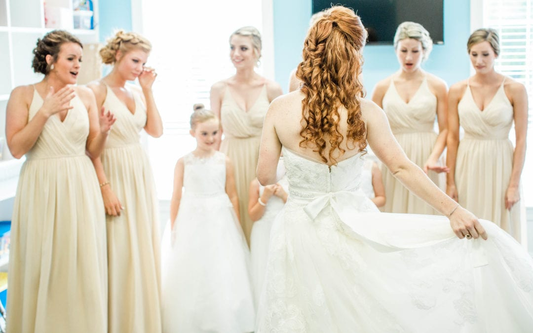 Real wedding, beautiful bride in her white wedding dress and bridesmaids