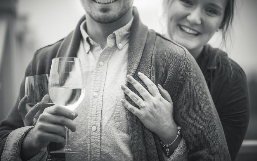 Couple is celebrating their engagement with friends at the vineyard
