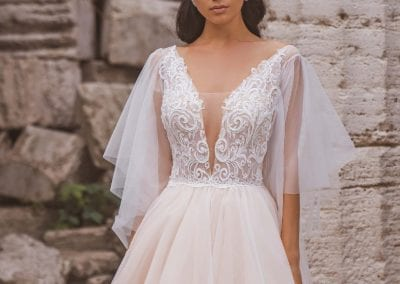 Low cut wedding dress with soft tulle