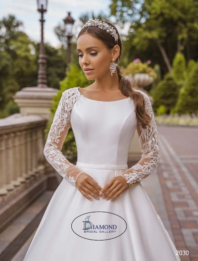 Satin wedding dress with lace sleeves