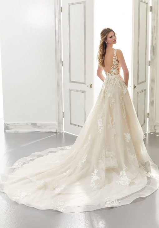 Beautiful ball gown with long train wedding dress