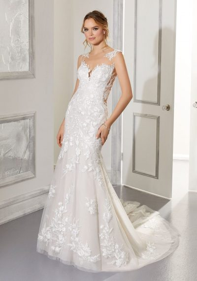 mesh top with some lace on this wedding dress