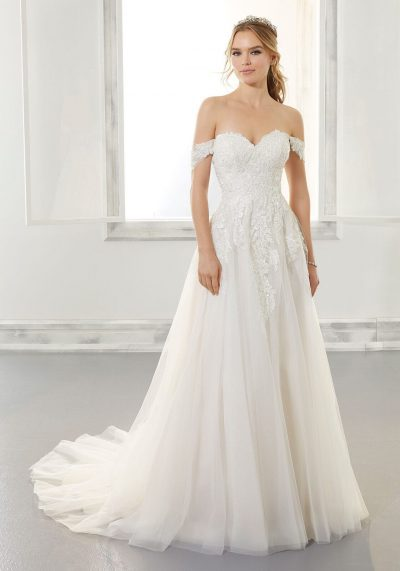 wedding dress in tulle and lace has a strapless bodice and a sweetheart neckline.