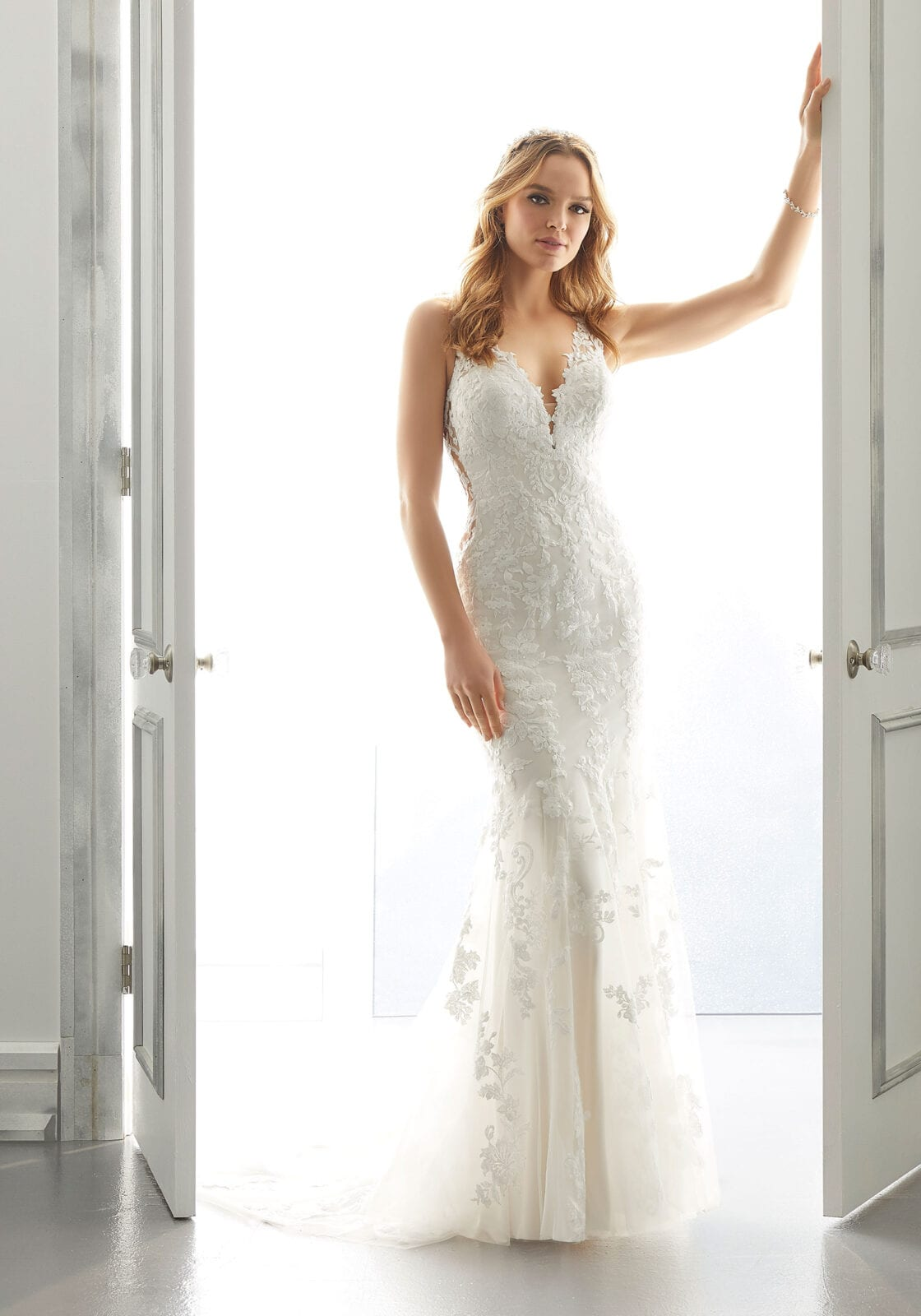 Colum and fit  flare wedding dress in Sacramento bridal store