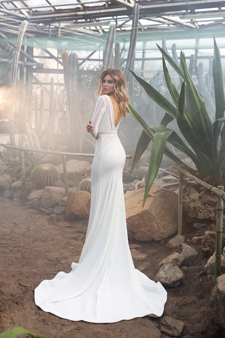 Wedding dress with low back and long sleeves